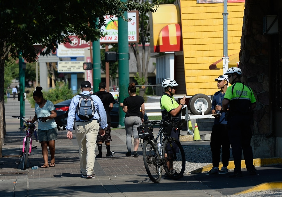 (Francisco Kjolseth | The Salt Lake Tribune) Bike officers work busy sidewalk along South Temple as the Salt Lake City Police Department hosts an open house near by on Wed. July 25, 2018, for a new substation that used to be an Arctic Circle restaurant at 837 West, South Temple. Newly-assigned bike officers and a sergeant will work out of the new substation to better serve the community on the West side.