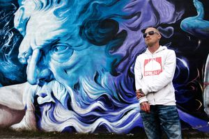 (Rick Egan  |  The Salt Lake Tribune)  Shae Petersen in front of one of his murals on 300 West and 3300 South in South Salt Lake.  Petersen is a muralist trying to get a mural painted on the side of the Exotic Kitty strip club in South Salt Lake. Friday, Dec. 15, 2017.