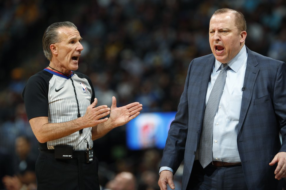 FILE - In this April 5, 2018, file photo, Minnesota Timberwolves coach Tom Thibodeau, right, argues for a call with referee Ken Mauer during the first half of the team's NBA basketball game against the Denver Nuggets, in Denver. Veterans Mike Callahan and Ken Mauer, along with first-timer David Guthrie, are among the 12 referees who have been selected to work the NBA Finals. The league announced the group Wednesday, May 30, 2018.(AP Photo/David Zalubowski, File)