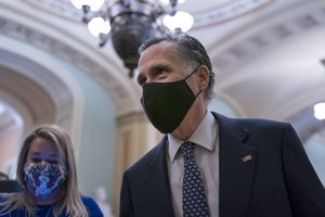 (J. Scott Applewhite | AP file photo) Sen. Mitt Romney, R-Utah, pauses to answer questions from reporters after the Senate voted to consider hearing from witnesses in the impeachment trial of former President Donald Trump on Feb. 13, 2021.