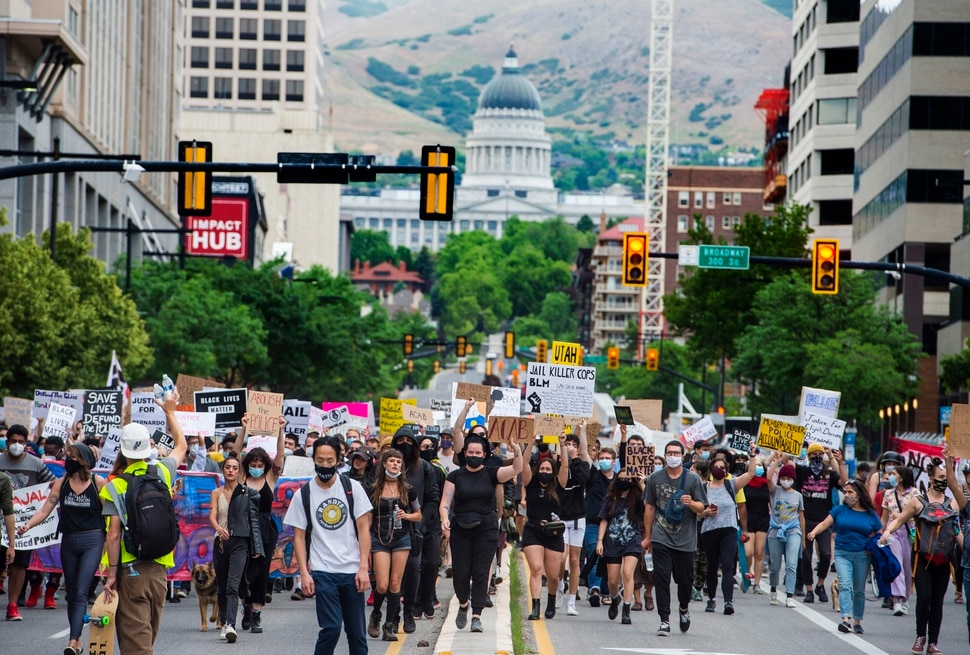 (Rick Egan | The Salt Lake Tribune) Protesters march down State Street in Salt Lake City on Saturday, June 13, 2020.