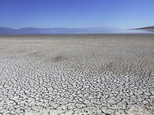 (Rick Bowmer | AP file photo) In this Aug. 26, 2019, photo, baked earth is shown along the receding edge of the Great Salt Lake near Antelope Island, Utah. Utah Gov. Spencer Cox signed an emergency order Wednesday declaring a state of emergency due to drought conditions.