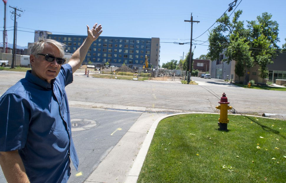 (Rick Egan | The Salt Lake Tribune) Gary James Bergera talks about the effect the Beck Street Transmission Project will have on the 400 North neighborhood, Friday, July 5, 2019.