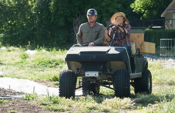 (Rick Egan | The Salt Lake Tribune) Elliot Musgrove and Amanda Theobald, owners of Top Crops, ride across the street to their urban farm in Salt Lake City, Tuesday, June 5, 2018.