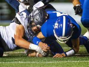 (Rick Egan  |  The Salt Lake Tribune)    James Lebaron, Corner Canyon, goes after the ball along to recover a Bingham fumble along with Bingham quarterback Troy Mehn, in prep action between the Bingham Miners and the Corner Canyon Chargers, at Bingham High onFriday, Aug. 28, 2020.