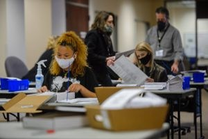 (Trent Nelson  |  Tribune file photo) Ballots are sorted at the Salt Lake County offices in Salt Lake City on Nov. 4, 2020. Utah state senators voted Thursday to make it harder for voters to switch parties.