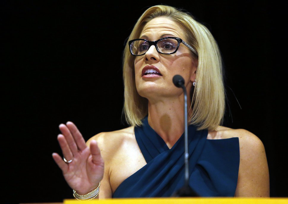 (AP Photo/Rick Scuteri) U.S. Sen.-elect Kyrsten Sinema, D-Ariz., speaks after being declared the winner over Republican challenger U.S. Rep. Martha McSally, Monday, Nov. 12, 2018, in Scottsdale, Ariz. Sinema won Arizona's open U.S. Senate seat in a race that was among the most closely watched in the nation, beating McSally in the battle to replace GOP Sen. Jeff Flake.