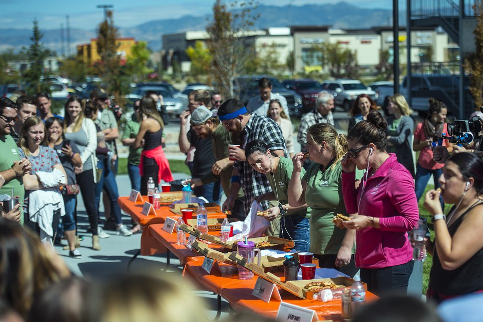 (Chris Detrick | The Salt Lake Tribune) Employees compete in a pizza-eating competition during a fundraiser for United Way at CHG Healthcare on Wednesday, Sept. 20, 2017.