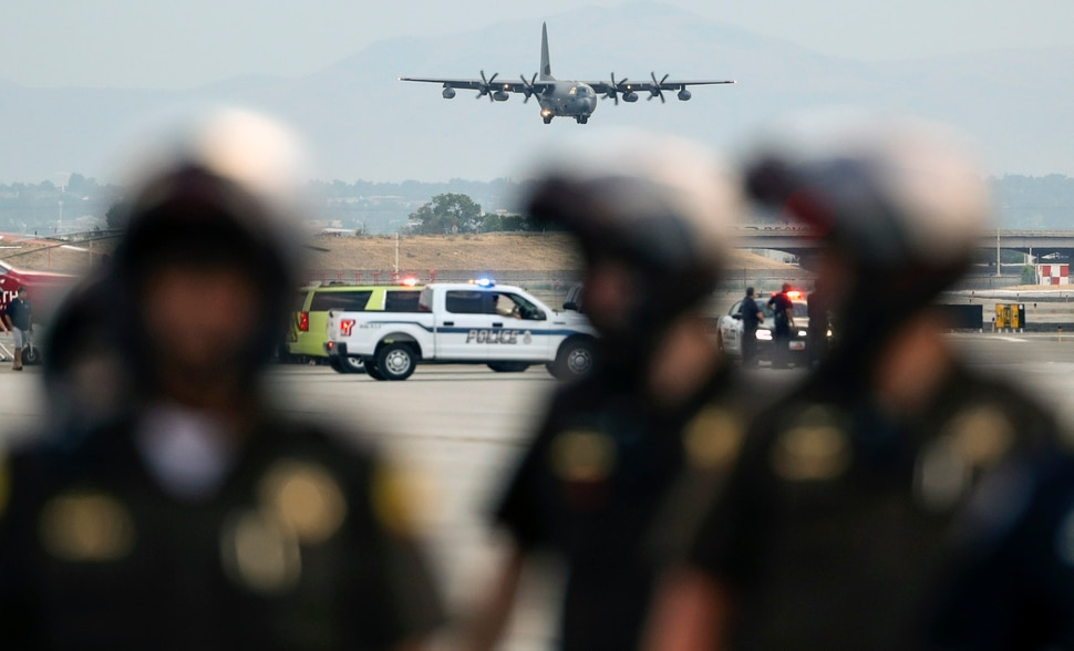 (Steve Griffin | Deseret News, pool photo) A C130-J carrying the casket of Draper Battalion Chief Matt Burchett prepares to landa at the Utah Air National Guard Base in Salt Lake City on Wednesday, Aug. 15, 2018. Burchett was killed while fighting the Mendocino Complex Fire north of San Francisco.
