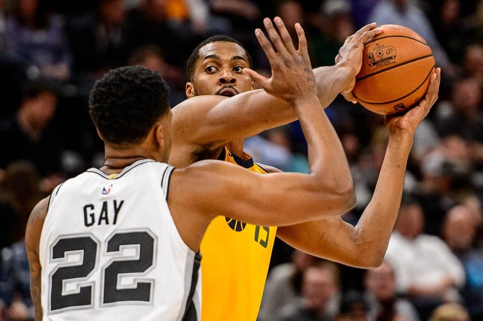(Trent Nelson | The Salt Lake Tribune) Utah Jazz forward Derrick Favors (15) defended by San Antonio Spurs forward Rudy Gay (22). Utah Jazz v San Antonio Spurs, NBA basketball in Salt Lake City on Tuesday Dec. 4, 2018.