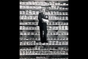 (Tom Kelly | Tribune file photo) Mac Christensen, the man behind the Mr. Mac clothing stores, poses on a ladder along shelves of dress shirts in the spring of 1990 in what was then his new store at 135 S. Main St. in Salt Lake City.