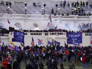 (John Minchillo   AP photo)  In this Jan. 6 photo, violent protesters storm the Capitol, in Washington.