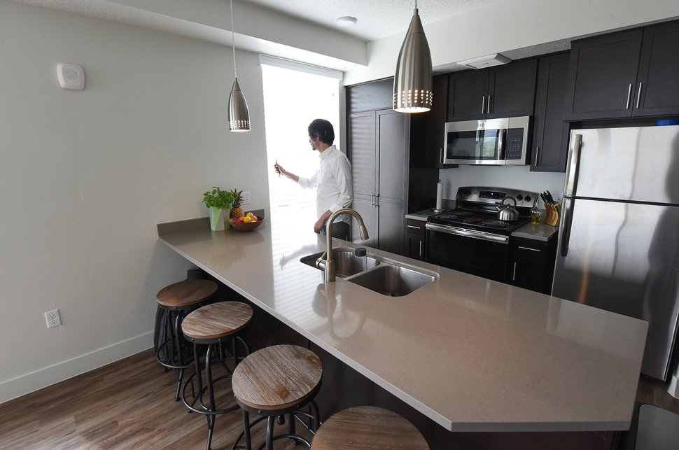 (Francisco Kjolseth | The Salt Lake Tribune) Chris Parker, who has been involved with Project Open, an affordable housing project northwest of downtown Salt Lake City, gives a tour of one of the 22-foot-wide apartment units on Thursday, May 10, 2018. Three affordable payment tiers offer options starting at $350 a month. Parker spent a year living on minimum wage, and then on the streets and in a van, to get a better idea of how to help those with more limited resources.