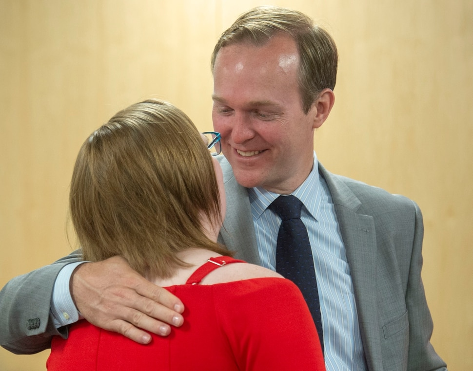 (Rick Egan | The Salt Lake Tribune) Congressman Ben McAdams gives Julia Ludlow a hug, after she spoke about her suicide attempt at a news conference about suicide prevention, Monday, July 8, 2019.