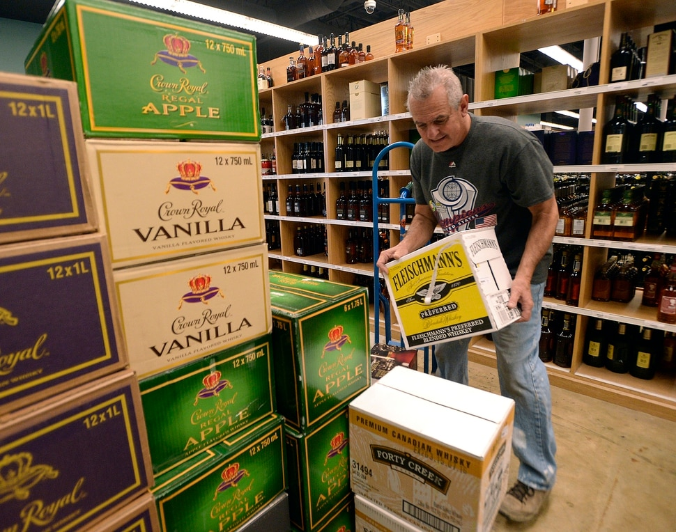 (Al Hartmann | The Salt Lake Tribune) Employee at the Cottonwood Heights state liquor store sorts through a big shipment of spirits Wednesday Nov. 22 to get it on the shelves. The Wednesday before Thanksgiving is typically one of the busiest days for liquor sales in Utah. Customers typically line up outside before the 11 a.m. opening. Extra employees work to handle the holiday rush.