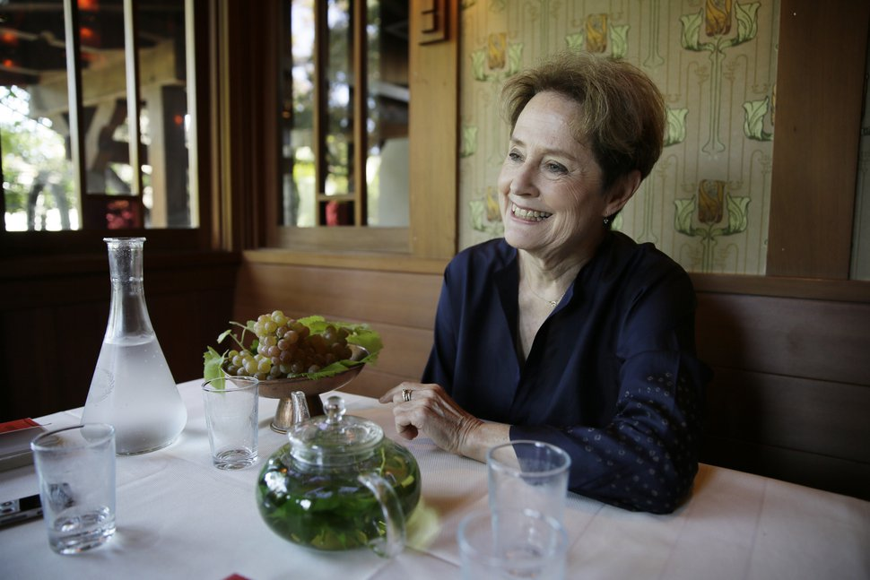 (Eric Risberg | AP file photo) In this Aug. 25, 2017, photo, Alice Waters, founder of Chez Panisse restaurant, listens to questions during an interview at the restaurant in Berkeley, Calif.