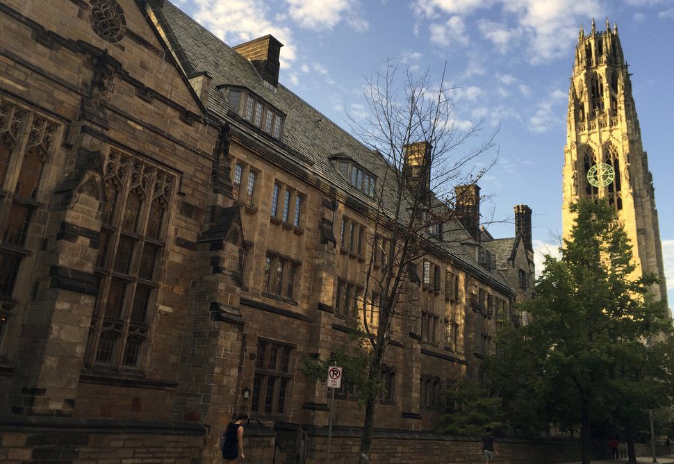 (AP Photo/Beth J. Harpaz, File) This Sept. 9, 2016, photo shows Harkness Tower on the campus of Yale University in New Haven, Conn.