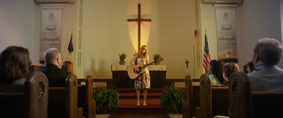 (photo courtesy Freestyle Releasing) Amber (Lindsay Pulsipher) prepares to sing in church for the first time in years, in the drama God Bless the Broken Road.