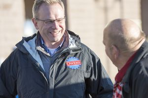 (Rick Egan     Tribune file photo) Doug Owens chats with Leroy Tharp as he campaigns in a shopping center in West Jordan, Monday, November 3, 2014
