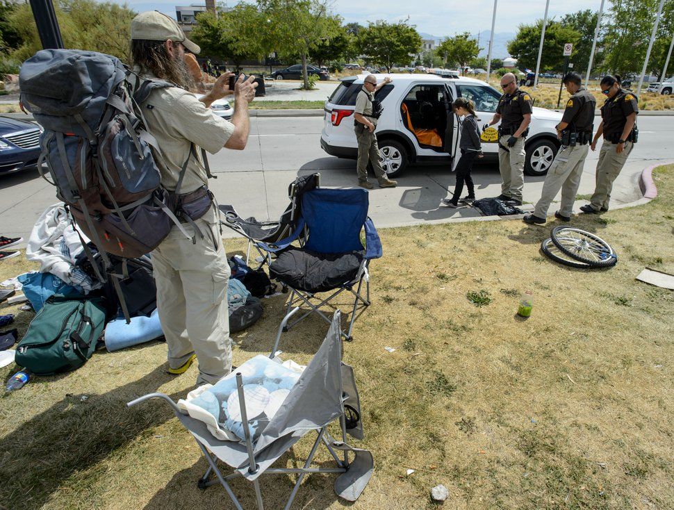 (Steve Griffin | The Salt Lake Tribune) UHP Troopers make an arrest on 500 west as law enforcement officers from several agencies increase their presence in the Rio Grand homeless area in Salt Lake City Monday August 14, 2017.