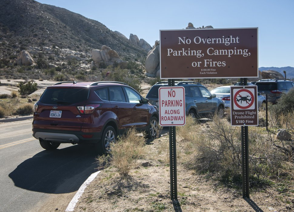 (Stuart W. Palley | The Washington Post) Cars illegally parked in a fire lane despite clear signage at the Ryan Mountain trailhead Saturday in Joshua Tree National Park.