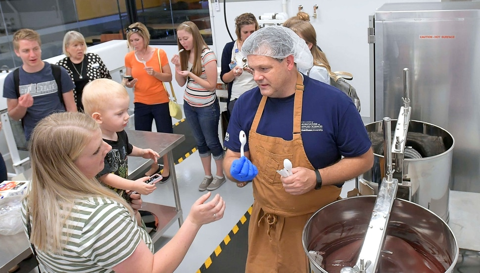 (Eli Lucero | The Herald Journal) Steve Shelton hands out samples during a public tour of the Aggie Chocolate Factory on Tuesday in Logan.