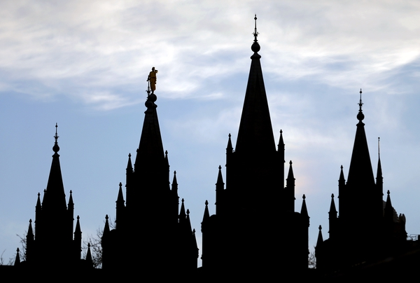 (AP file photo) The Salt Lake Temple, at Temple Square, as seen in 2018. Utahns' personal actions on air quality varied widely depending on their religious and political views, according to a recent Salt Lake Tribune-Hinckley Institute of Politics poll.
