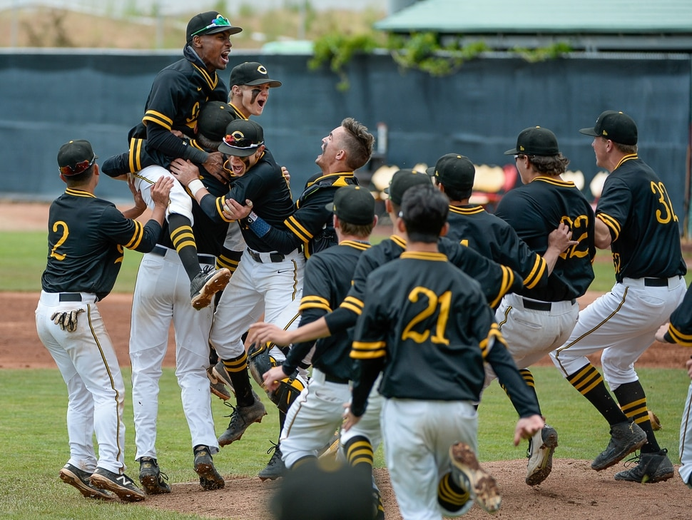 (Francisco Kjolseth | The Salt Lake Tribune) Cottonwood pitcher Carson Angeroth is mobbed by his teammates after striking out Timpanogos 6-5 win during the 5A baseball championship game at UCCU Stadium on the UVU campus in Orem, Friday, May 24, 2019.
