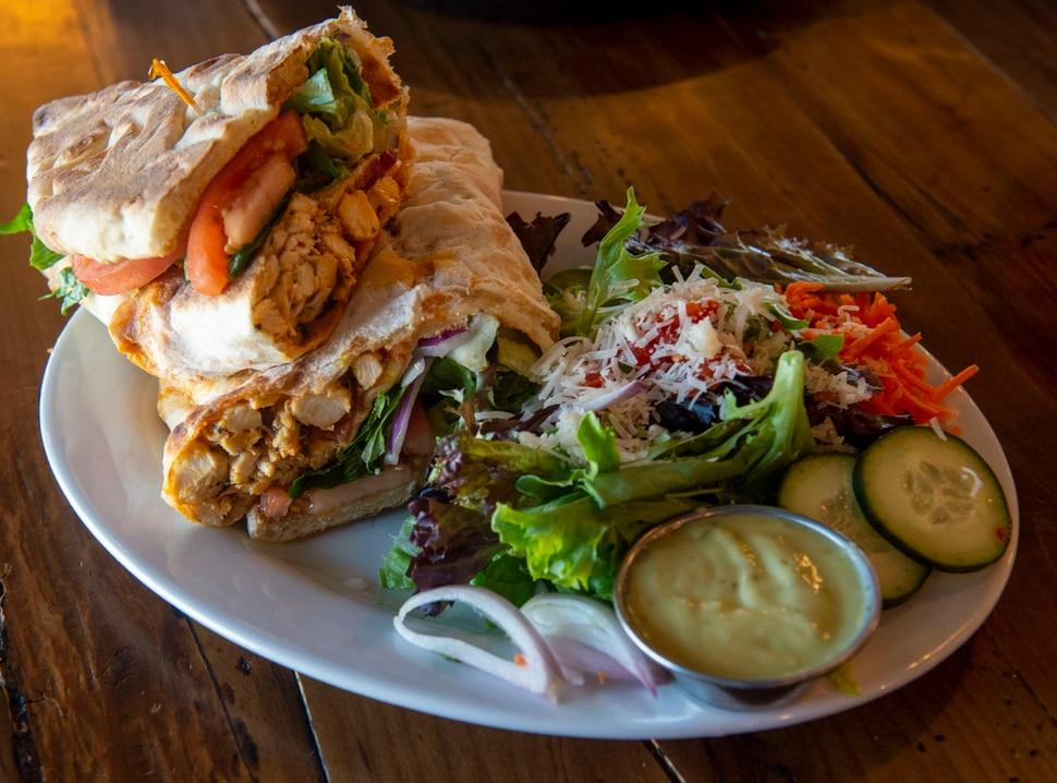 (Rick Egan | The Salt Lake Tribune) Buffalo Chicken Sandwich with House Salad, at Slackwater Pizzeria in Sandy, Thursday, March 5, 2020.