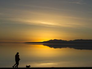(Rick Egan | Tribune file photo) A sunset along the shore of Willard Bay in January 2018. Willard Bay ranked as the third most-visited state park in 2020.