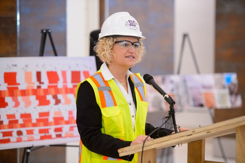 (Trent Nelson   The Salt Lake Tribune) Salt Lake City Mayor Jackie Biskupski speaks at a news conference showcasing the art by 18 local and national artists chosen to be featured in the new Salt Lake City airport as the Whimsy Wall Art Project, on Friday, Nov. 1, 2019. The piece behind her on the left is Nancy Bardach's Acceleration Decelerating.