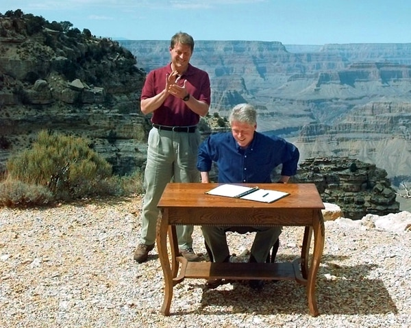 (AP Photo/Doug Mills, File) In this Sept. 18, 1996, file photo, Vice President Al Gore applauds after President Bill Clinton signs a bill designating about 1.7 million acres of land in southern Utah's red-rock cliff as the Grand Staircase-Escalante National Monument, at the Grand Canyon National Park, in Arizona.