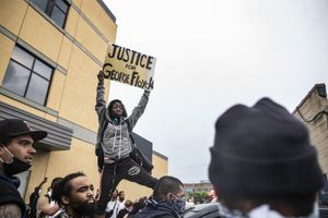 Protesters gather near the Minnesota Police 3rd Precinct during a gathering Tuesday, May 26, 2020, in response to the death the day before of George Floyd in police custody. Four Minneapolis officers involved in the arrest of Floyd, a black man who died in police custody, were fired Tuesday, hours after a bystander's video showed an officer kneeling on the handcuffed man's neck, even after he pleaded that he could not breathe and stopped moving. (Richard Tsong-Taatarii/Star Tribune via AP)