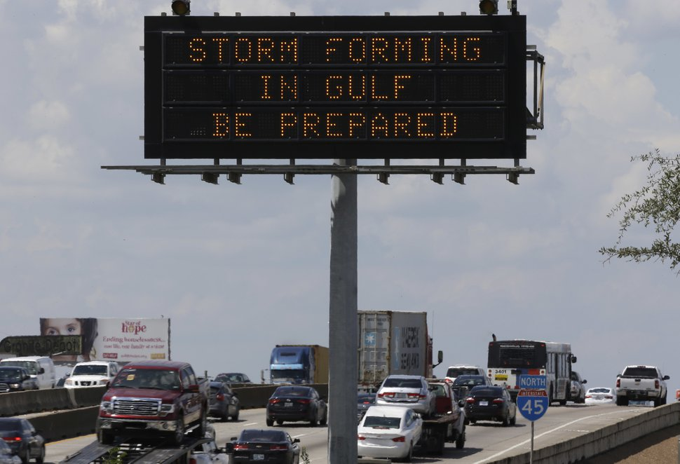 (David J. Phillip | The Associated Press) Motorists in Houston pass a sign warning of Hurricane Harvey as the storm intensifies in the Gulf of Mexico, Thursday, Aug. 24, 2017. Harvey is forecast to be a major hurricane when it makes landfall along the middle Texas coastline Friday.