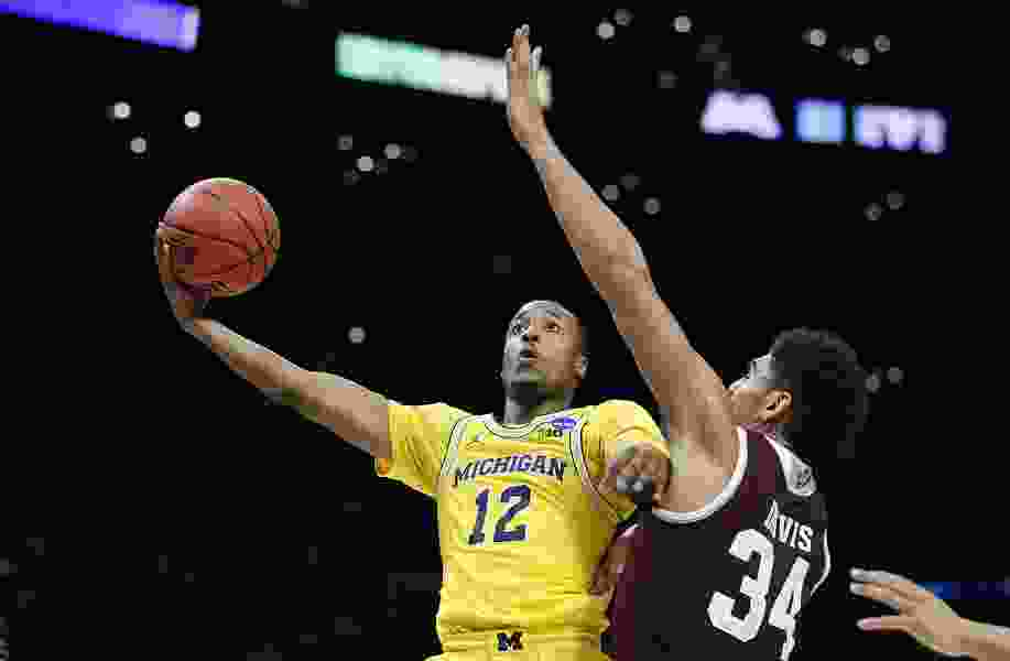 Streaking Michigan routs Texas A&M 99-72 in West semifinals