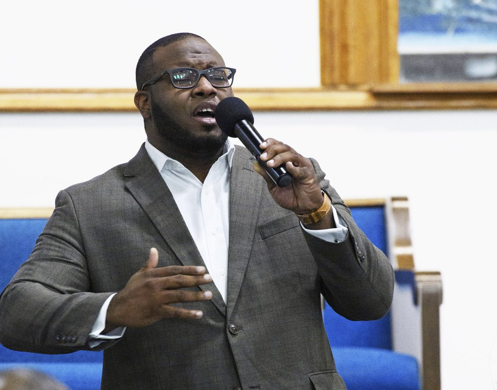 (Jeff Montgomery/Harding University via AP) This Sept. 21, 2017, file photo provided by Harding University in Search, Ark., shows Botham Jean leading worship at a university presidential reception in Dallas. A grand jury began hearing evidence Monday, Nov. 26, 2018, in the case of former Dallas police officer Amber Guyger, who fatally shot Jean, her unarmed black neighbor, in his own apartment after she said she mistook it for hers on Sept. 6, 2018.