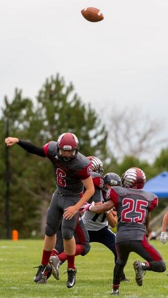 Trent Nelson | The Salt Lake Tribune Layton Christian quarterback Grayson Jackson loses a very high snap while facing Duchesne, high school football in Layton Thursday August 21, 2014.