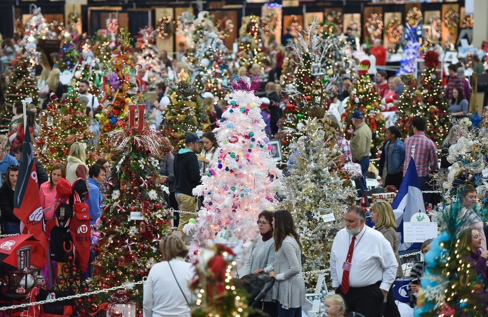 (Francisco Kjolseth | The Salt Lake Tribune) People tour the Festival of Trees at the South Towne Exposition Center in Sandy on Friday, Dec. 1, 2017. The annual festival which runs through Saturday raises money for children at Primary Children's Hospital.