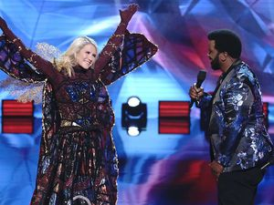 "(Photo courtesy of Michael Becker | Fox) Elizabeth Smart and host Craig Robinson on ""The Masked Dancer."""