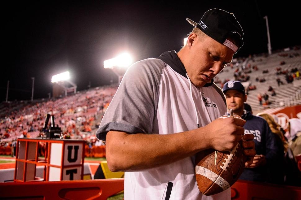 (Trent Nelson   The Salt Lake Tribune) Garett Bolles signs a football as the University of Utah hosts Stanford, NCAA football at Rice-Eccles Stadium in Salt Lake City Saturday October 7, 2017.