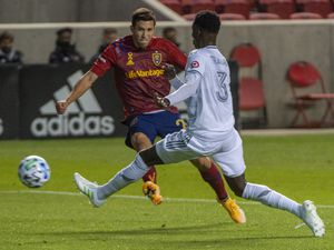 (Rick Egan  |  The Salt Lake Tribune).  Real Salt Lake defender Aaron Herrera (22) kicks the ball as Los Angeles FC Mohamed Traore defends, in MLS soccer action between Real Salt Lake and Los Angeles FC at Rio Tinto Stadium, on Wednesday, Sept. 9, 2020.