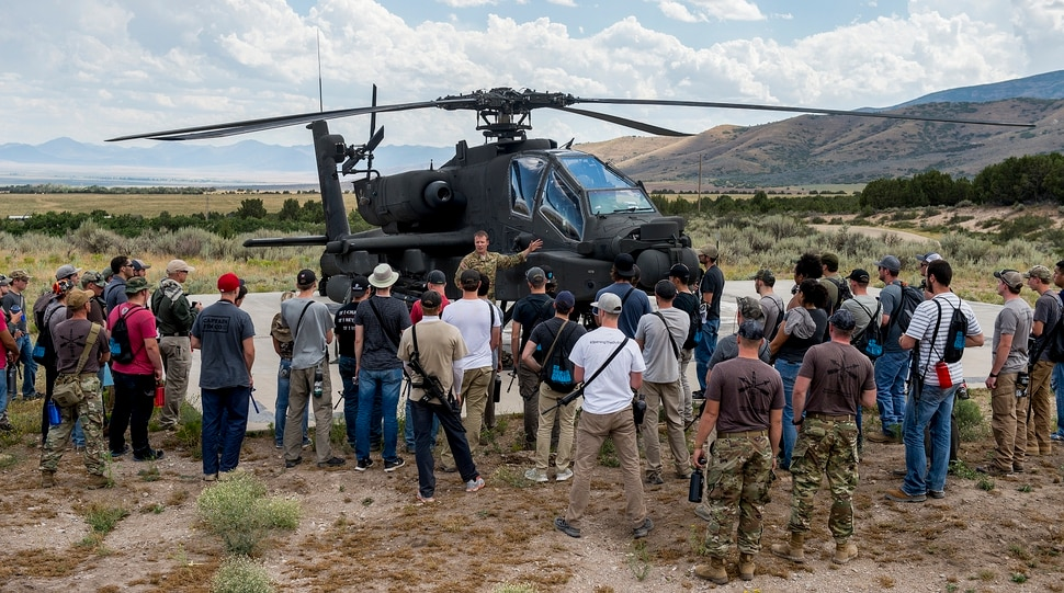 (Leah Hogsten | The Salt Lake Tribune) CW4 Stu Smith with the 1st Battalion of the 211th Aviation Regiment gives details about his training, what it's like to fly an Apache and details about the helicopter at the Utah National Guard Special Forces Survival Training Experience, August 10-12, 2017 at Camp Williams.