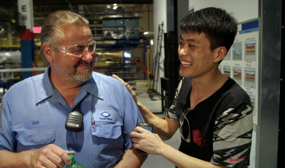 (Ian Cook | Courtesy of Sundance Institute) Rob Haerr, left, and Wong He are unexpected co-workers at an Ohio auto-glass plant begun by a Chinese billionaire in