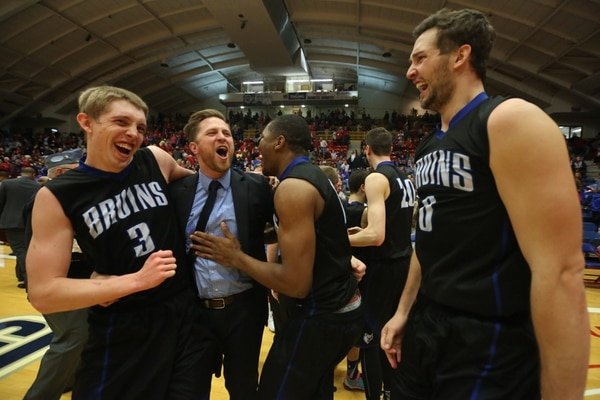Salt Lake's Tyler Rawson, assistant coach Brian Swindlehurst, Christian Musoko and Gibson Johnson after winning the championship game of the NJCAA tournament 74-63 over Hutchinson Saturday, March 19, 2016 at the Sports Arena in Hutchinson, Kan. (Travis Morisse/The Hutchinson News via AP ) MANDATORY CREDIT