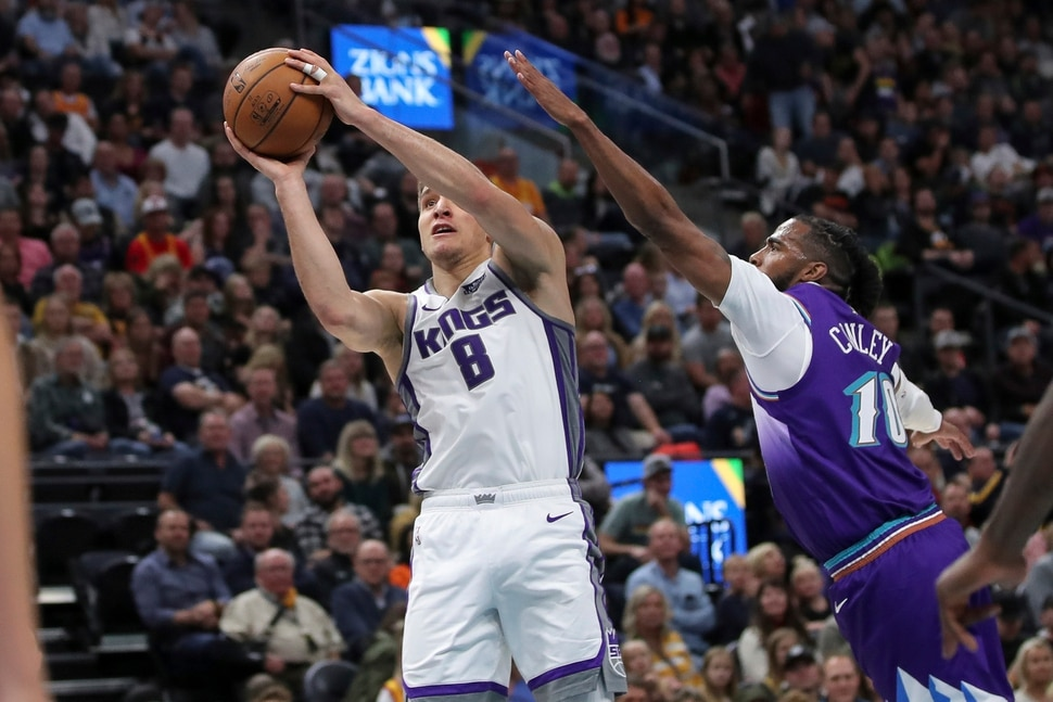 Sacramento Kings guard Bogdan Bogdanovic (8) shoots past Utah Jazz guard Mike Conley (10) during the second quarter of an NBA basketball game, Saturday, Oct. 26, 2019, in Salt Lake City. (AP Photo/Chris Nicoll)