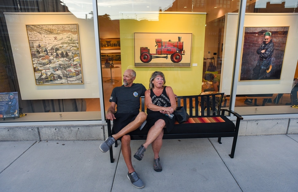 (Francisco Kjolseth | The Salt Lake Tribune) Taking in the scene on a warm summer evening, 44-year locals Mike and Cindy Schmitz enjoy Helper's First Fridays gallery stroll on Friday, Aug. 2, 2019. The monthly event draws all ages with activities, food, and artists opening up their studios and galleries to visitors.