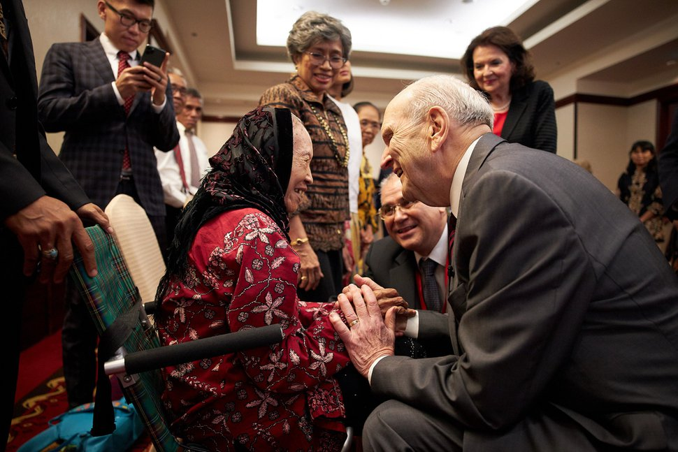 (Photo courtesy of The Church of Jesus Christ of Latter-day Saints) President Russell M. Nelson greets a member in Jakarta.