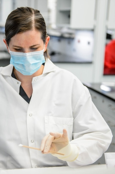 (Trent Nelson | The Salt Lake Tribune) Hannah Bennett, a forensic scientist working in the biology section of the Department of Safety Forensic Services lab, processing evidence from a sexual assault collection kit, in Taylorsville on Tuesday May 7, 2019.