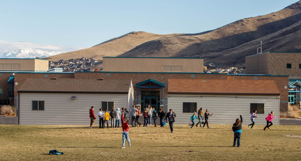 (Trent Nelson | Tribune file photo) Students at recess at Butterfield Canyon Elementary in Herriman, which has 14 portable classrooms. On Wednesday, several Utah civil and architectural engineering groups called for more stringent building standards on the hundreds of portable classrooms in use across the state, saying current rules may be putting students at risk.