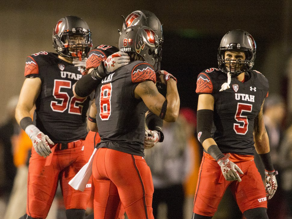 Rick Egan | The Salt Lake Tribune Team mates encourage Utes wide receiver Kaelin Clay (8) after his fumble resulted in an Oregon touchdown, in PAC-12 action, Utah vs. Oregon game, at Rice-Eccles Stadium, Saturday, November 8, 2014